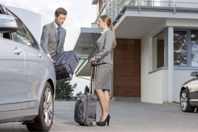 man and woman beside car